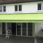 Lovely on trend lime green with the silver framework on this Weinor Topas awning with LED Lighting bar.