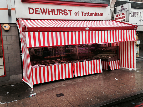 Fully enclosed shop front awning with side curtains