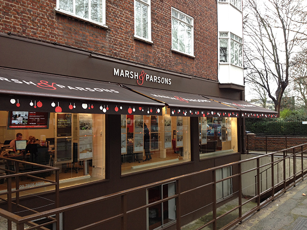 A tricky installation here but the awnings look great. Christmas themed sign writing is eye catching and fun!