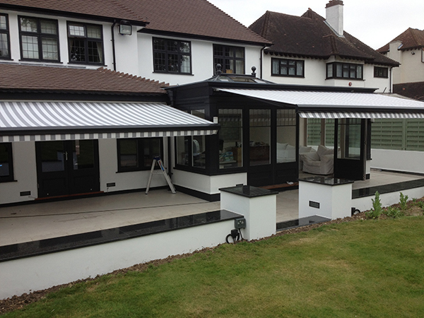 Classy awning installation over this gorgeous patio area.