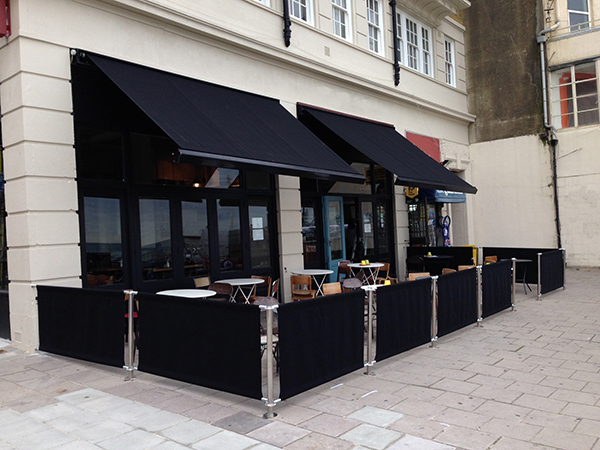 Awnings and Barriers are a great way to section off an outside area, add heaters to attract more custom!